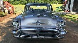1956 Oldsmobile black cherry and light pewter